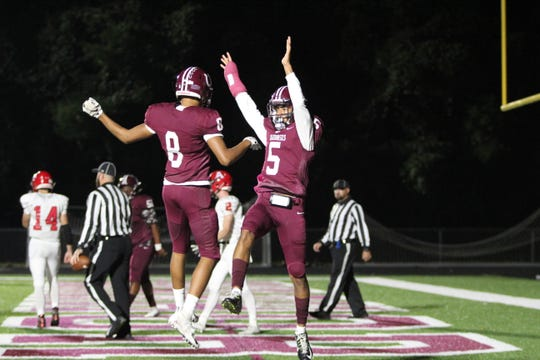 Owen senior Ty Davidson (5) celebrates his first quarter touchdown with junior Fred Graves as the Warhorses knock off Avery, 48-0.