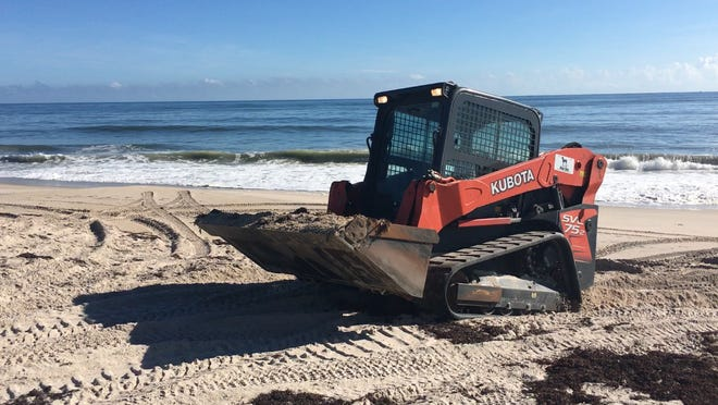 A dozer plows along Tracking Station Beachside Park in Vero Beach Saturday.