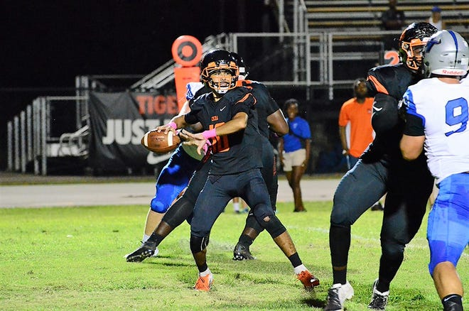 Diego Arroyo rares back and fires one downfield Friday night during the Tigers homecoming game against the Bartram Trail Bears.