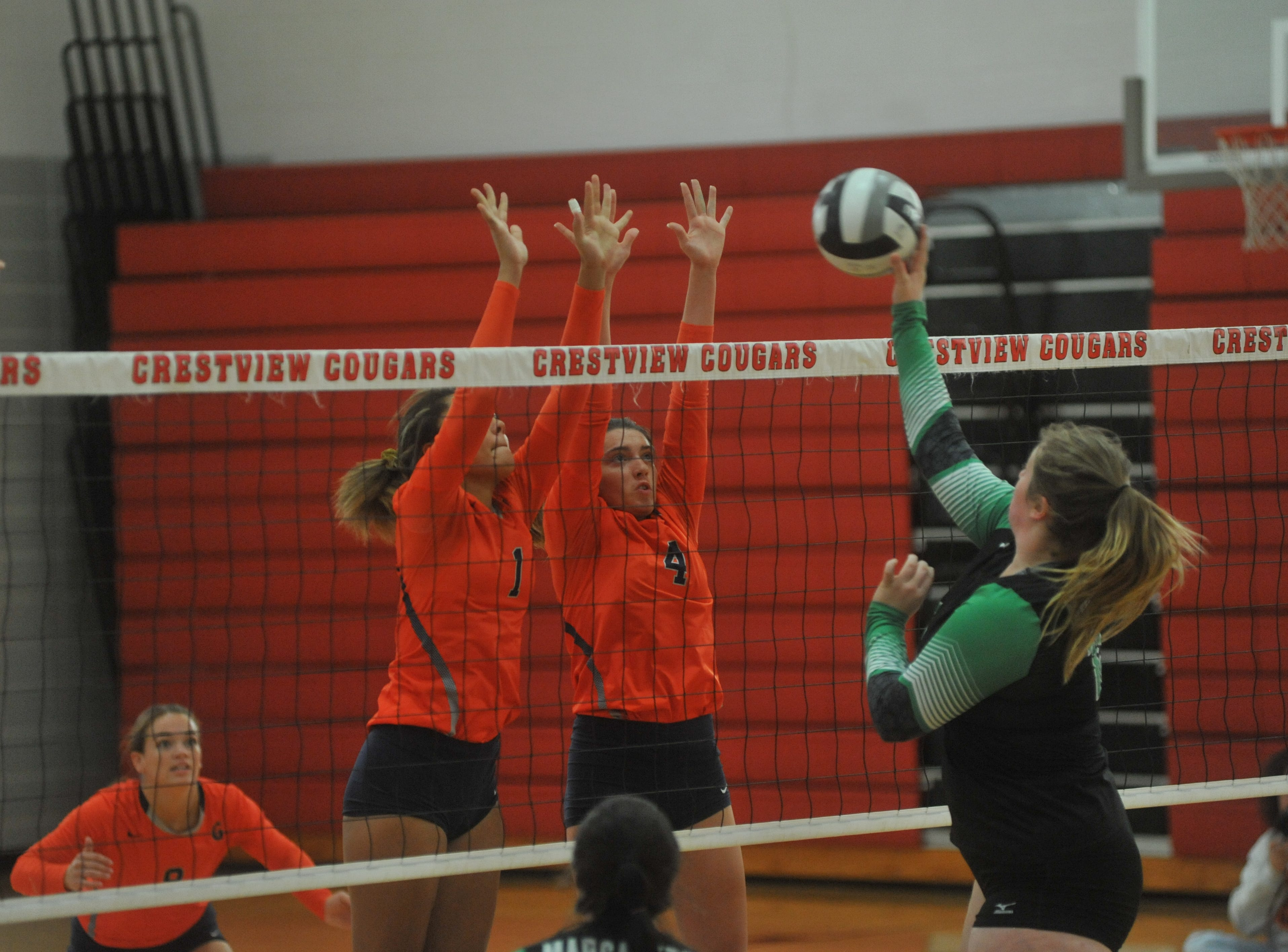 Galion's Brooklyn Cosey and Jaden Ivy jump up to attempt a block.