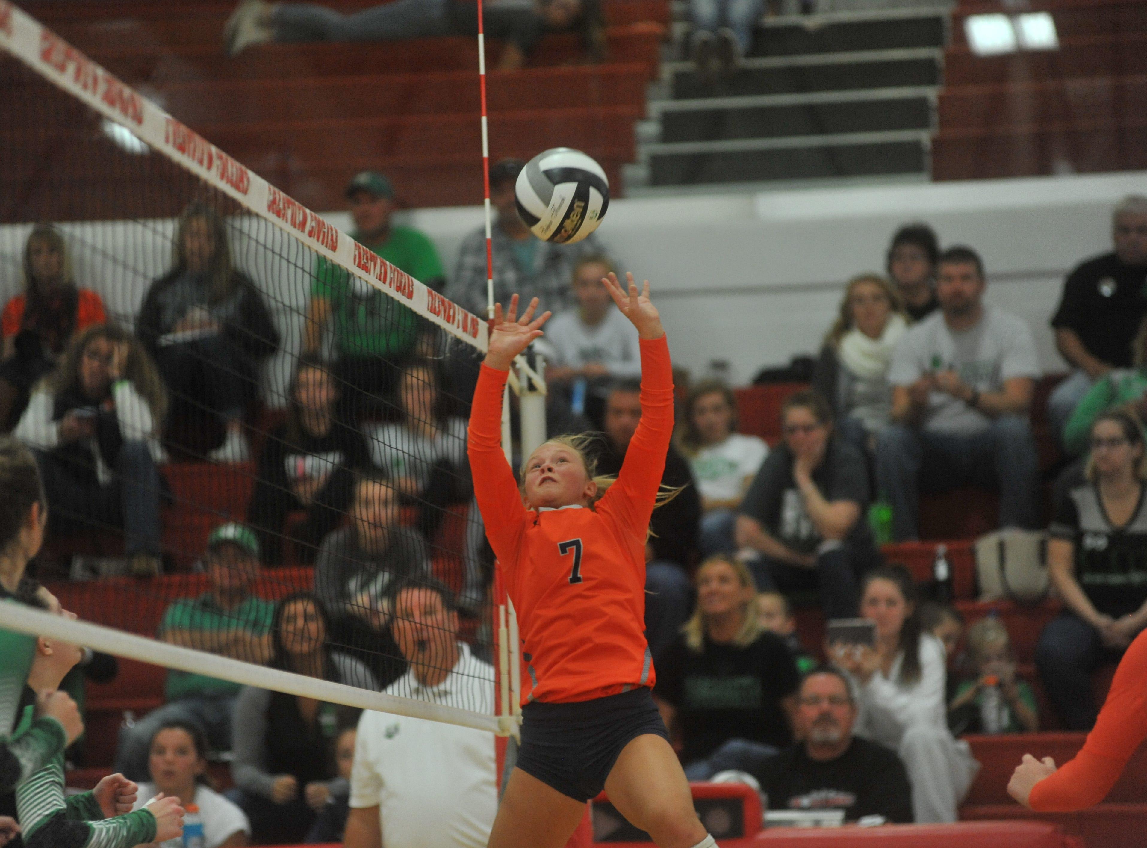 Galion's Kayla Hardy sets a teammate.