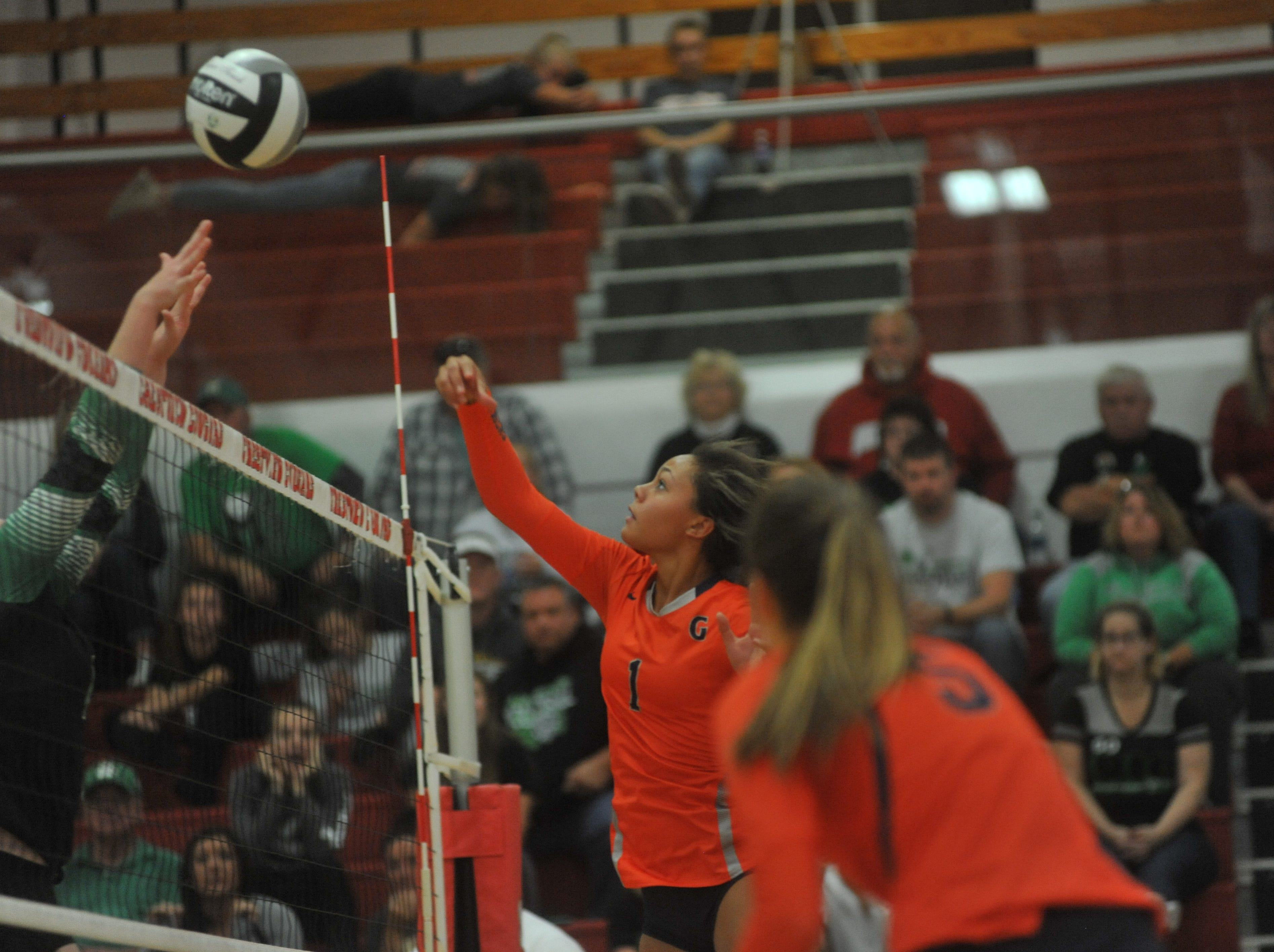 Galion's Brooklyn Cosey pushes a ball over the net.