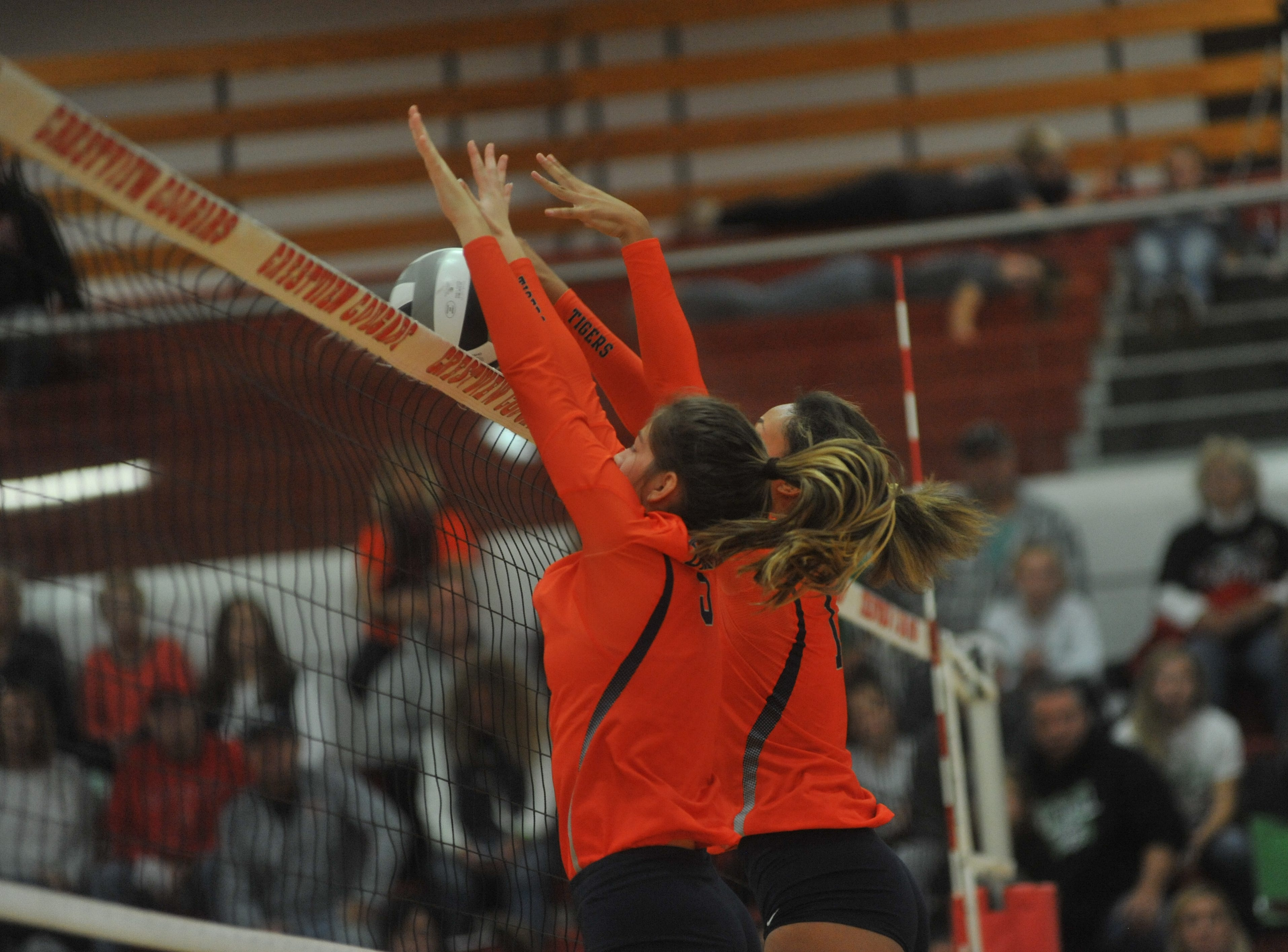 Galion's Gillian Miller and Brooklyn Cosey block a ball at the net.