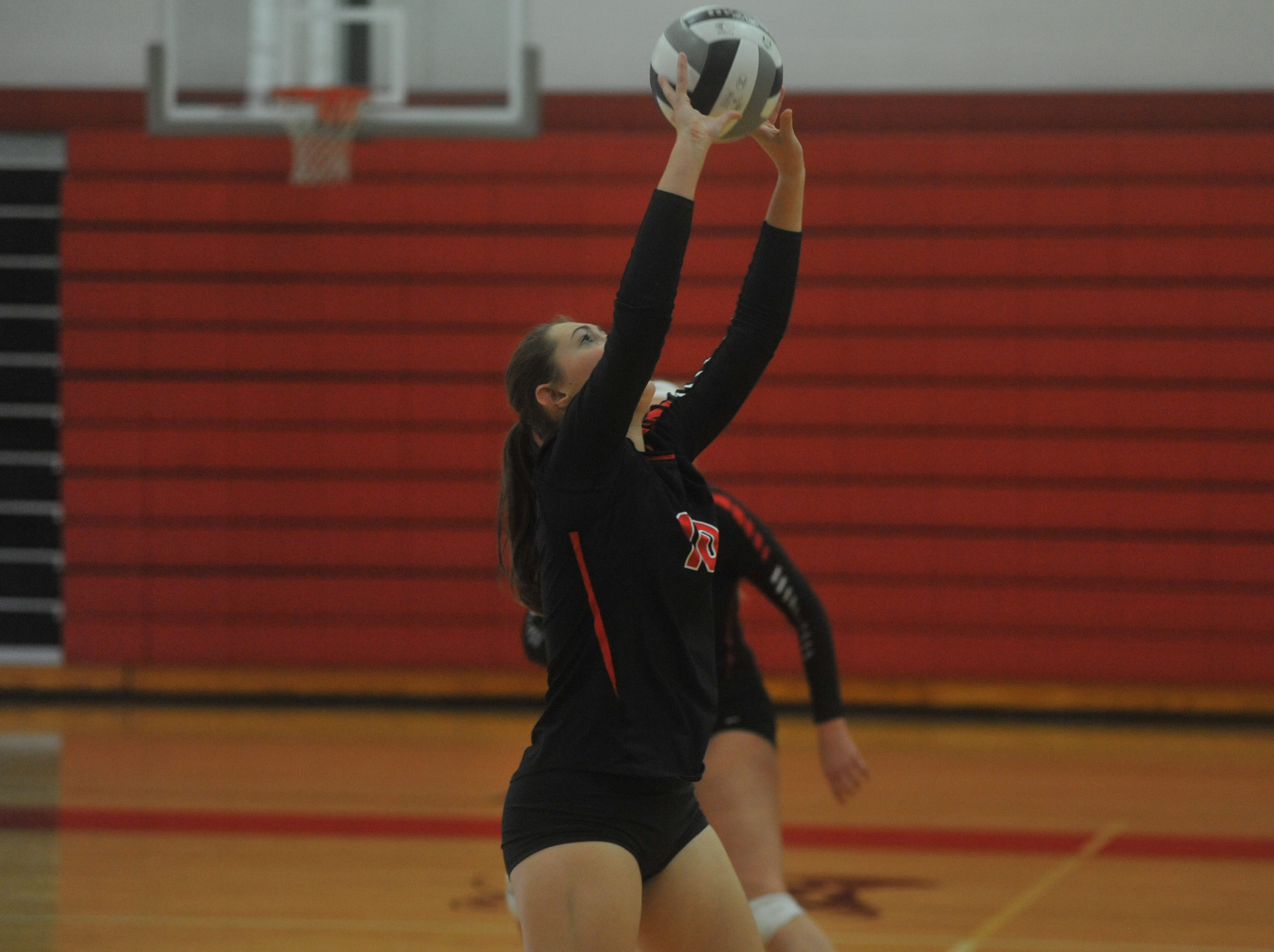 Crestview's Elly Motter sets a teammate.