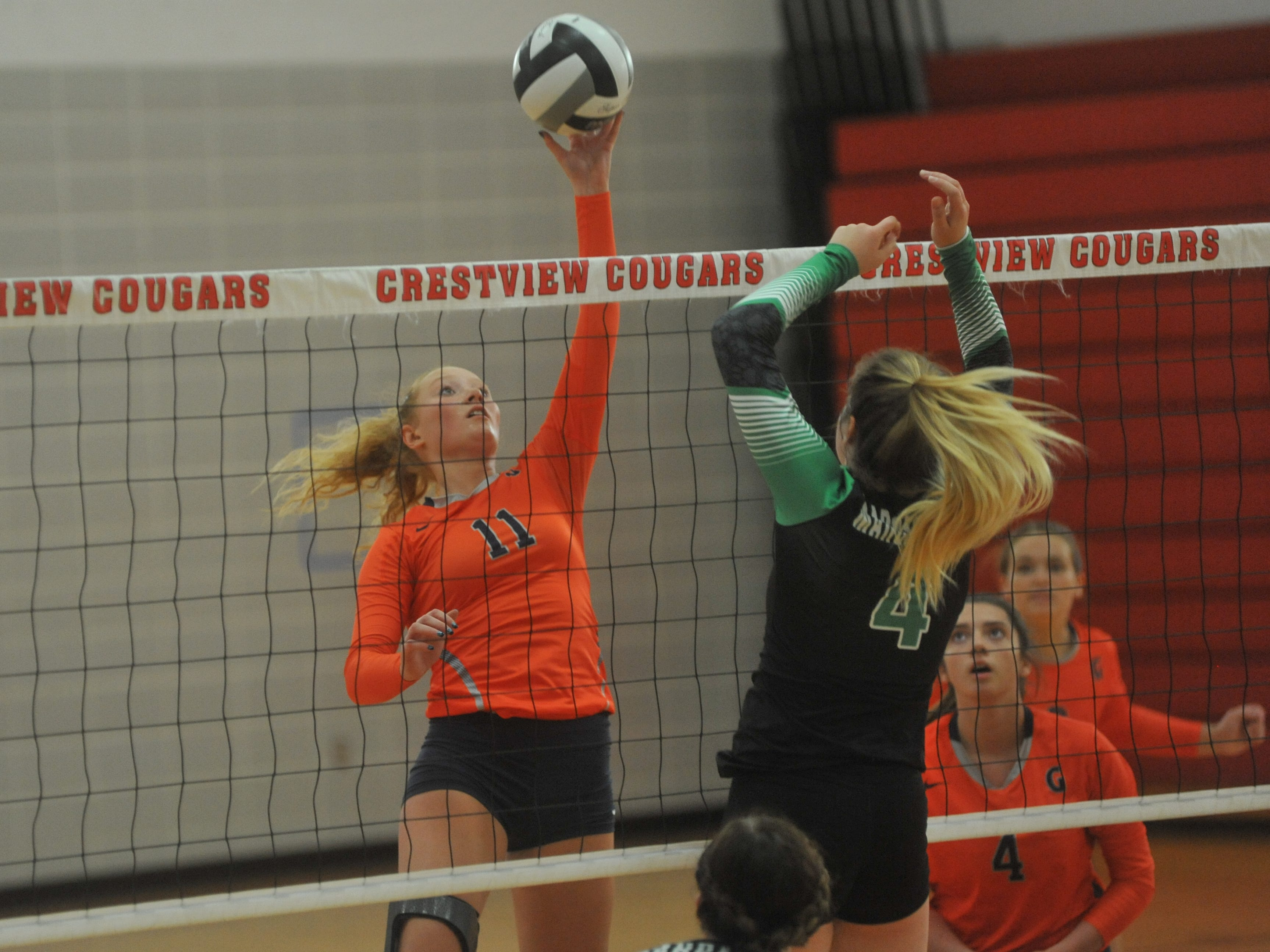 Galion's Gracie Groves tips a ball over the net.