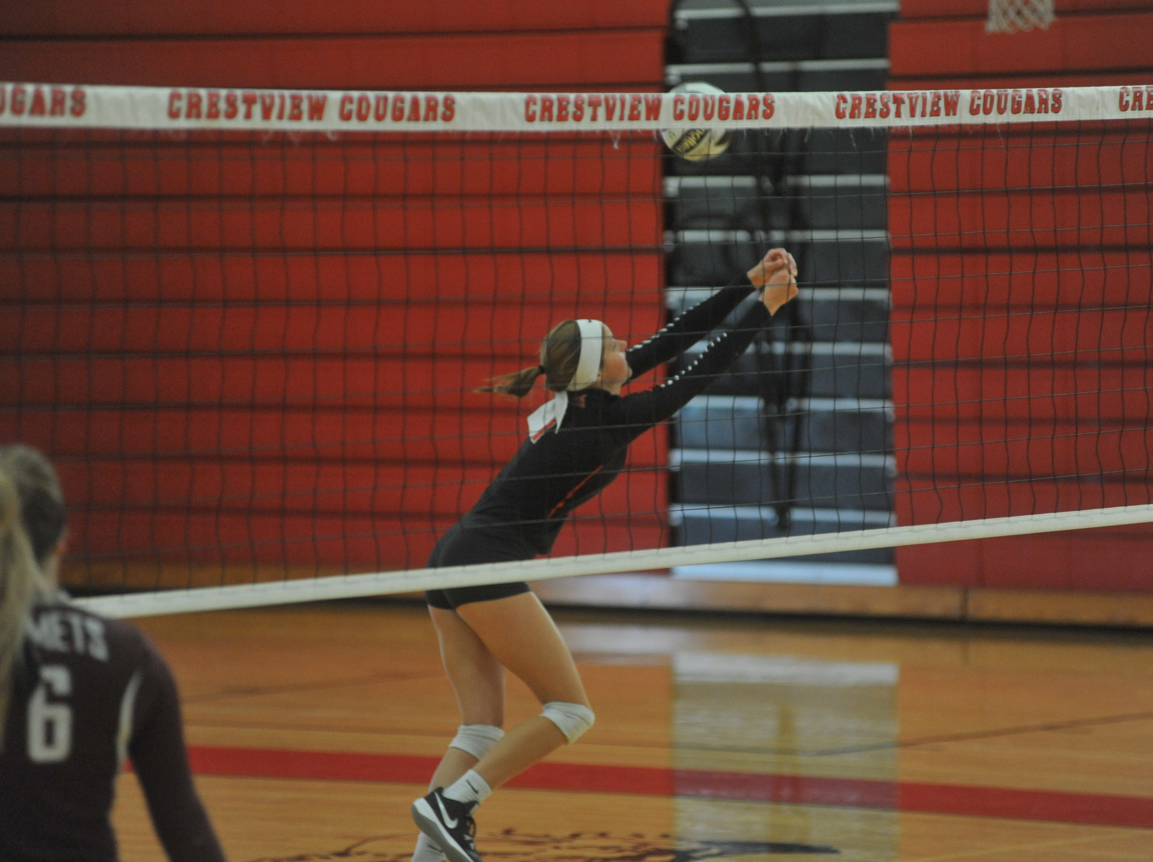 Crestview's Natalie Restille reaches for a ball.