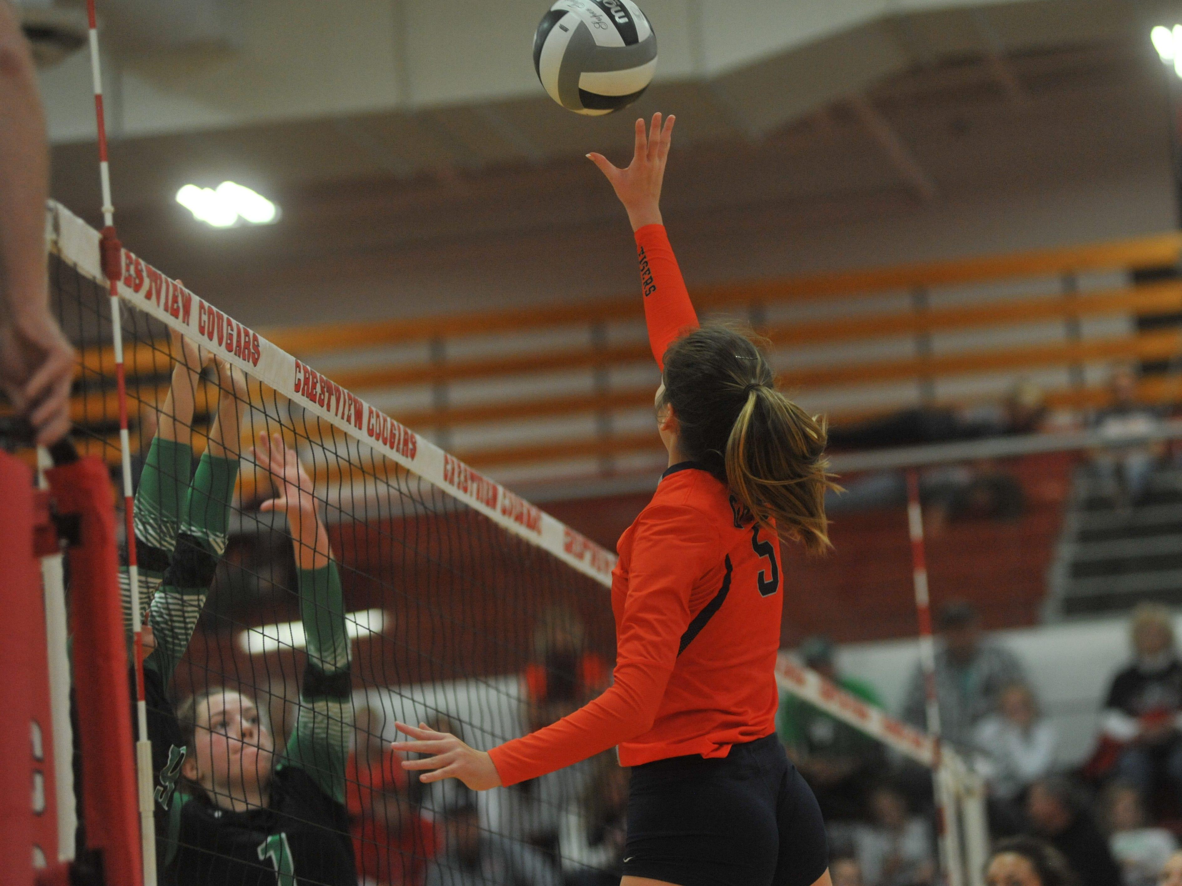 Galion's Gillian Miller tips a ball over the net.