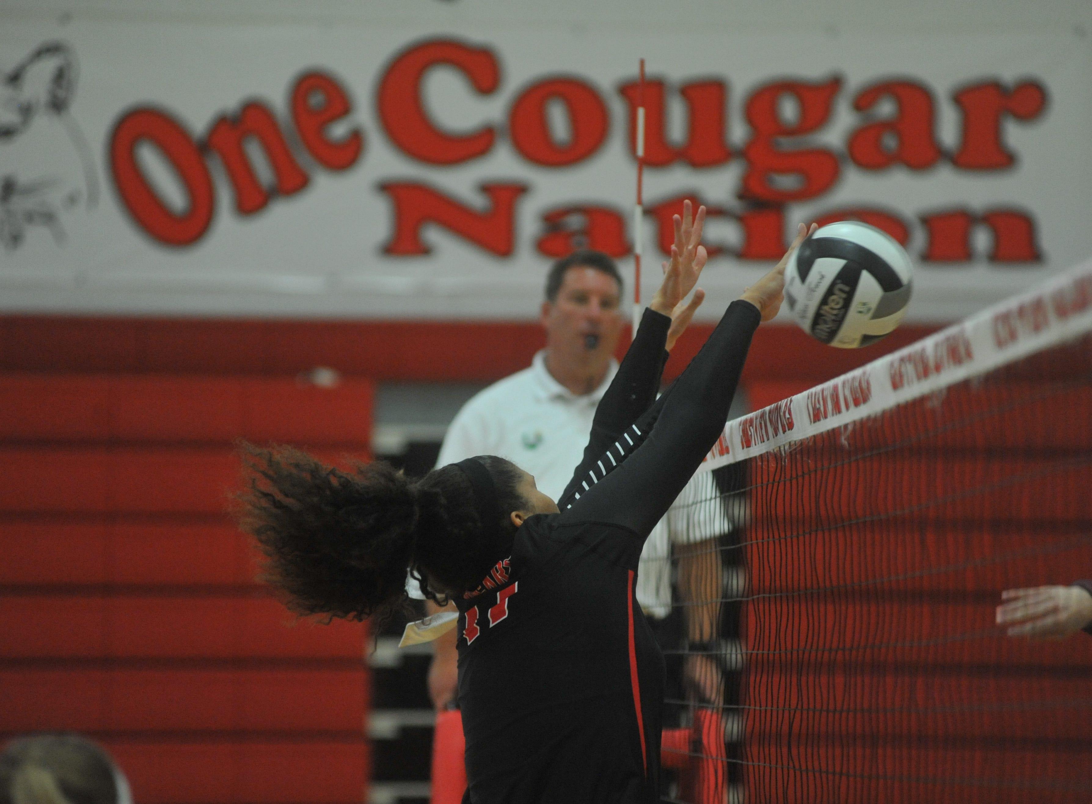 Crestview's Kyla Brafford blocks a ball at the net.