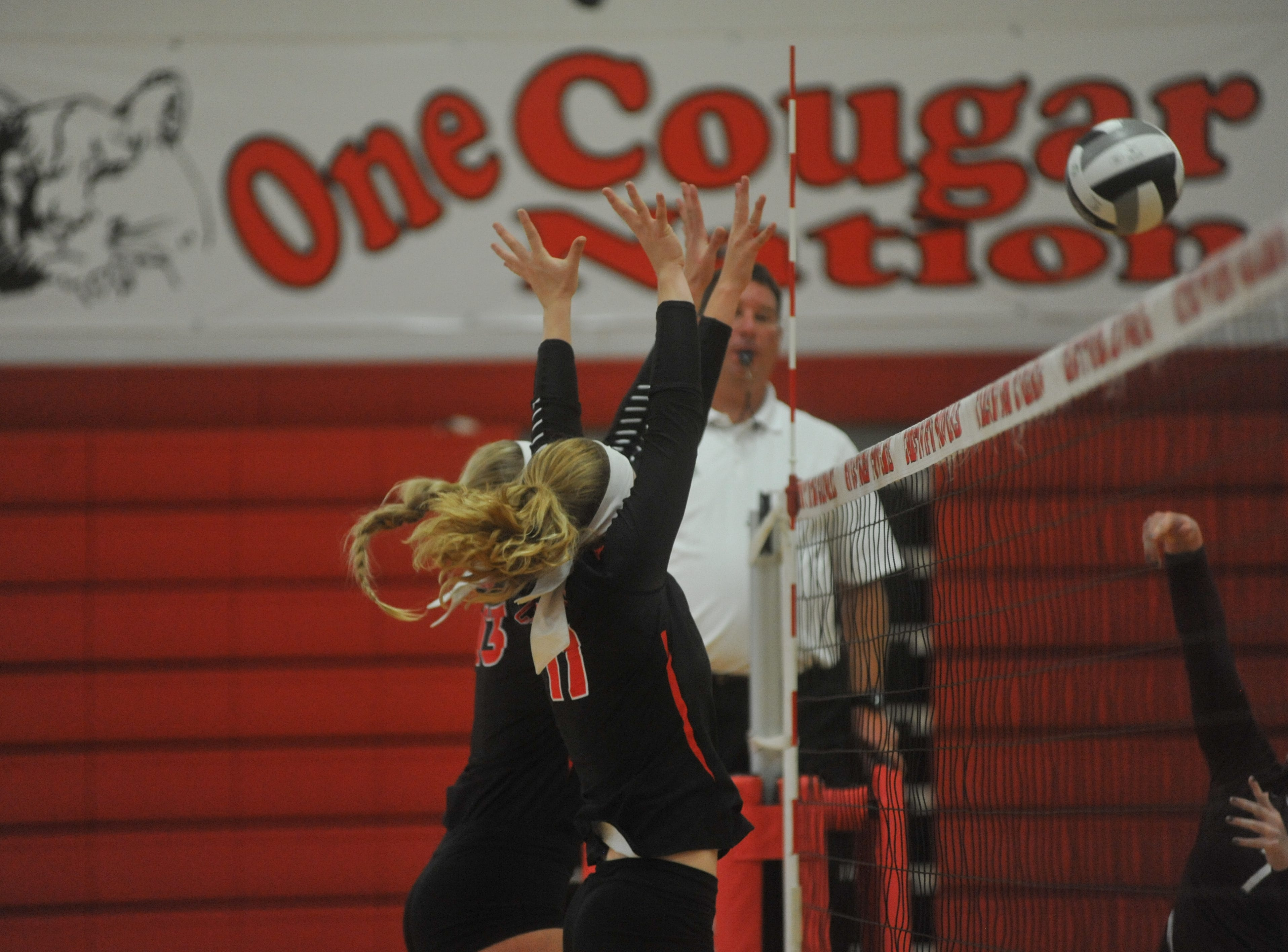 Crestview's Autumn Bailey and Kenedi Goon jump up for a block.