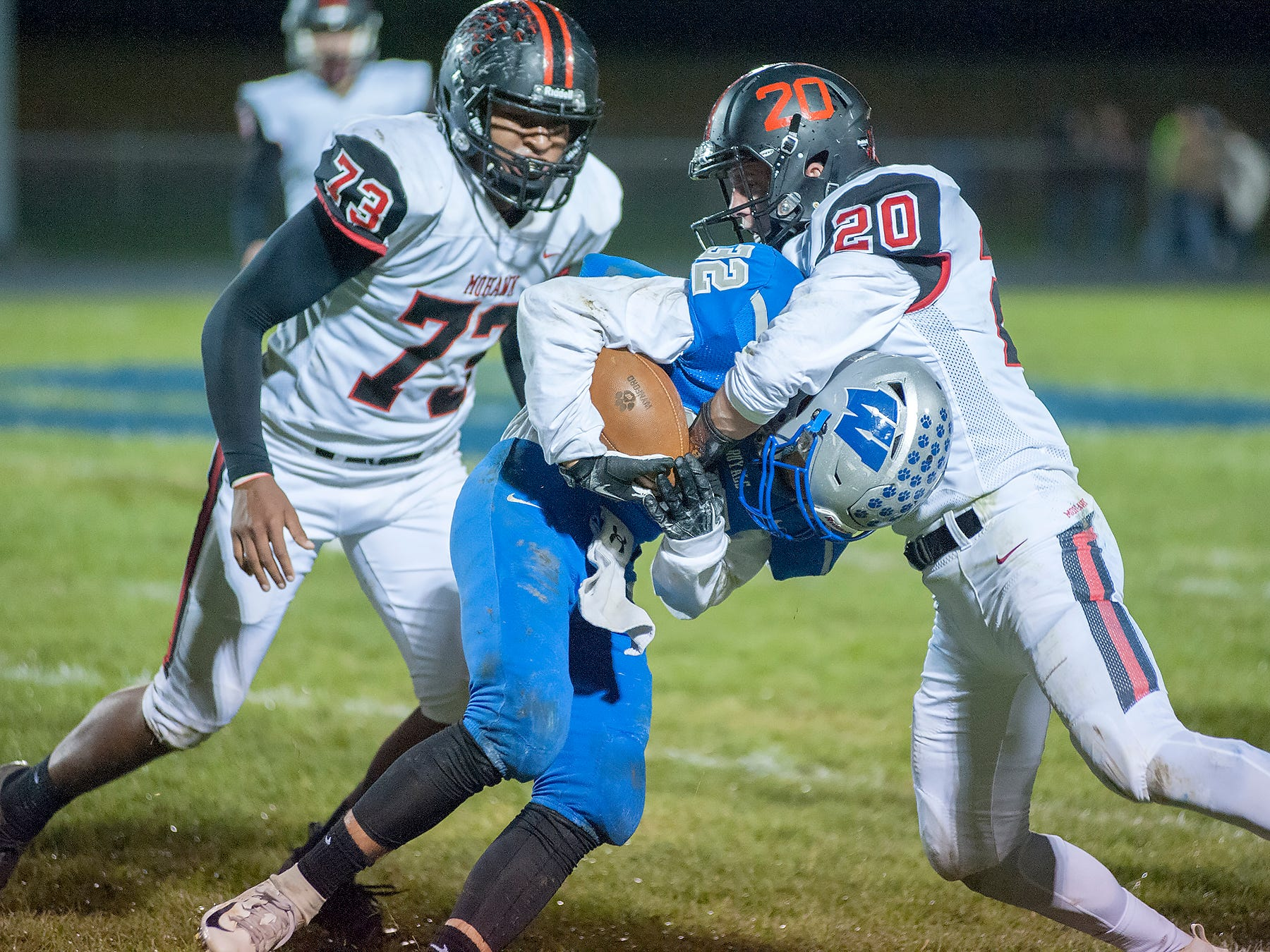 Wynford's Seth Benedict is tackled by Mohawk's Zach Hayman.