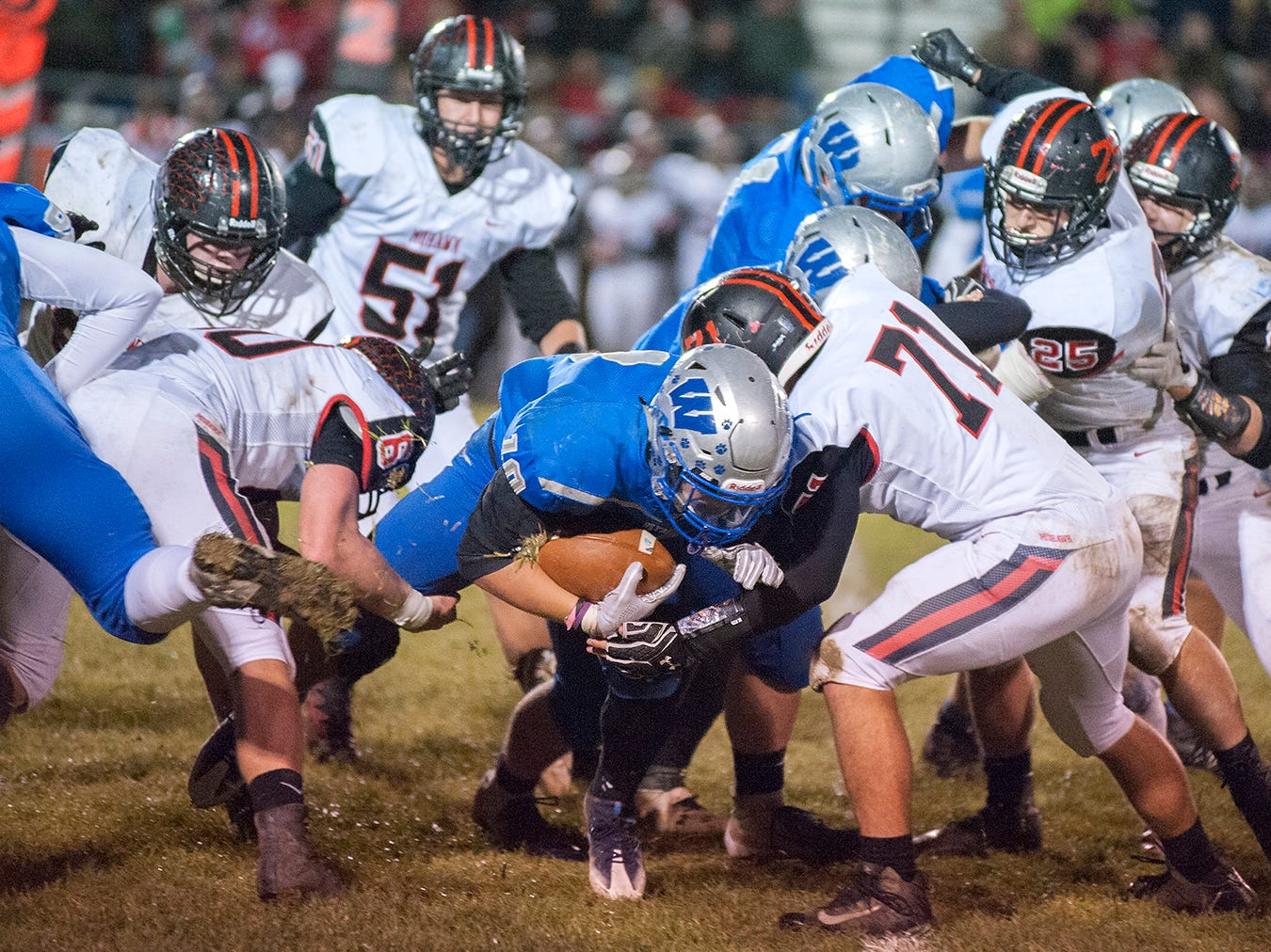 Wynford's Blake Sparks is tackled while rushing.