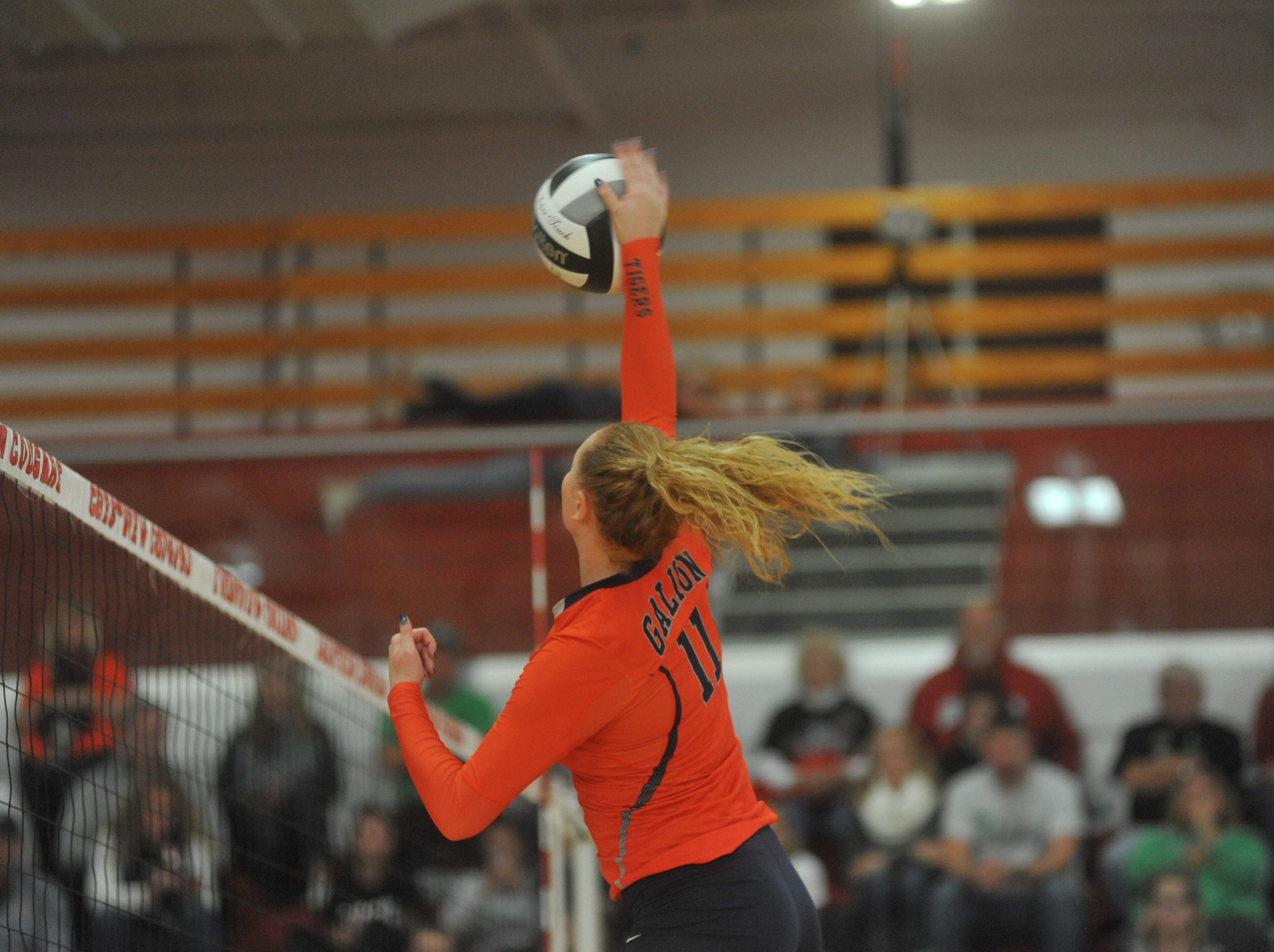 Galion's Gracie Groves spikes a ball at the net.