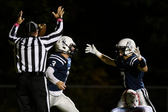 Burlington celebrates a touchdown during the high school football game between the Rutland Raiders and the Burlington/South Burlington SeaWolves at Buck Hard Field on Friday night October 19, 2018 in Burlington.