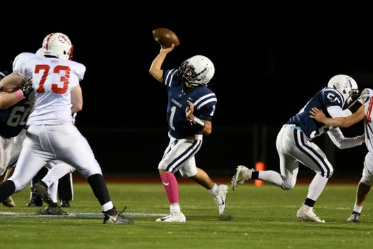 Burlington's Kevin Papariello (1) throws a pass during the high school football game between the Rutland Raiders and the Burlington/South Burlington SeaWolves at Buck Hard Field on Friday night October 19, 2018 in Burlington.