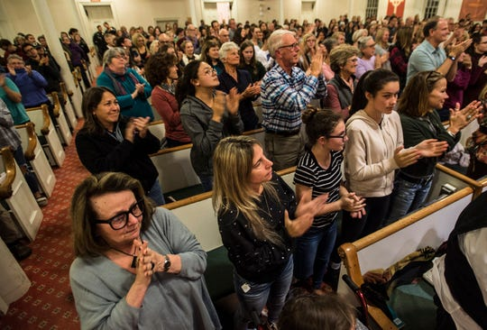 "A sold-out crowd applauds three survivors of the Marjory Stoneman Douglas High School shooting in Parkland, Florida, Alex Wind, David Hogg and Emma Gonz‡lez, after the three spoke Friday night, Oct. 18, 2018, at the First Unitarian Universalist Society of Burlington, Vt., part of a six-city tour promoting their book ""Glimmer of Hope: How Tragedy Sparked a Movement."""