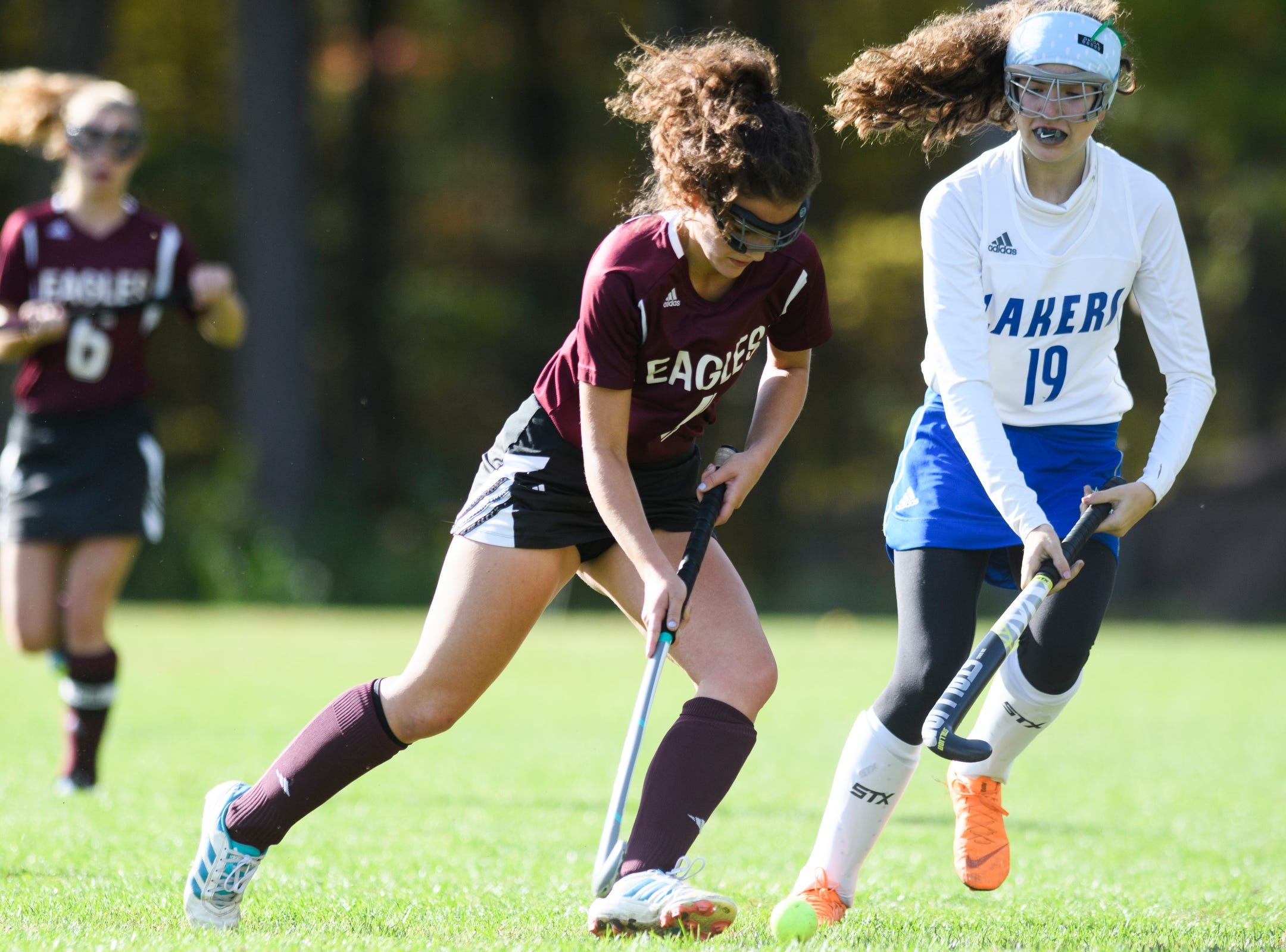 Mt. Abraham's Casondra Dykstra (4) runs down the field with the ball past Colchester's Piper Kendrick (19) during the field hockey game between Mount Abraham and Colchester at Colchester High School on Saturday morning October 20, 2018 in Colchester.