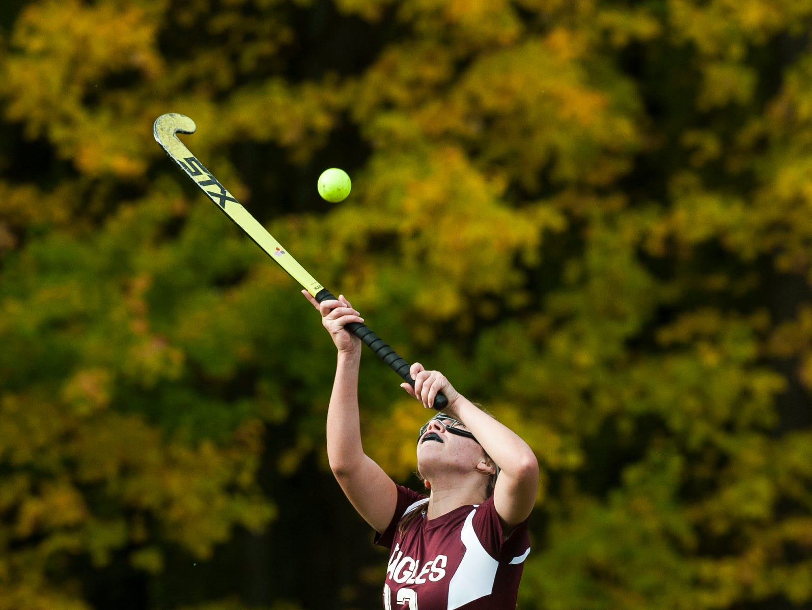 Mt. Abraham's Abby Hoff (13) plays the high ball during the field hockey game between Mount Abraham and Colchester at Colchester High School on Saturday morning October 20, 2018 in Colchester.