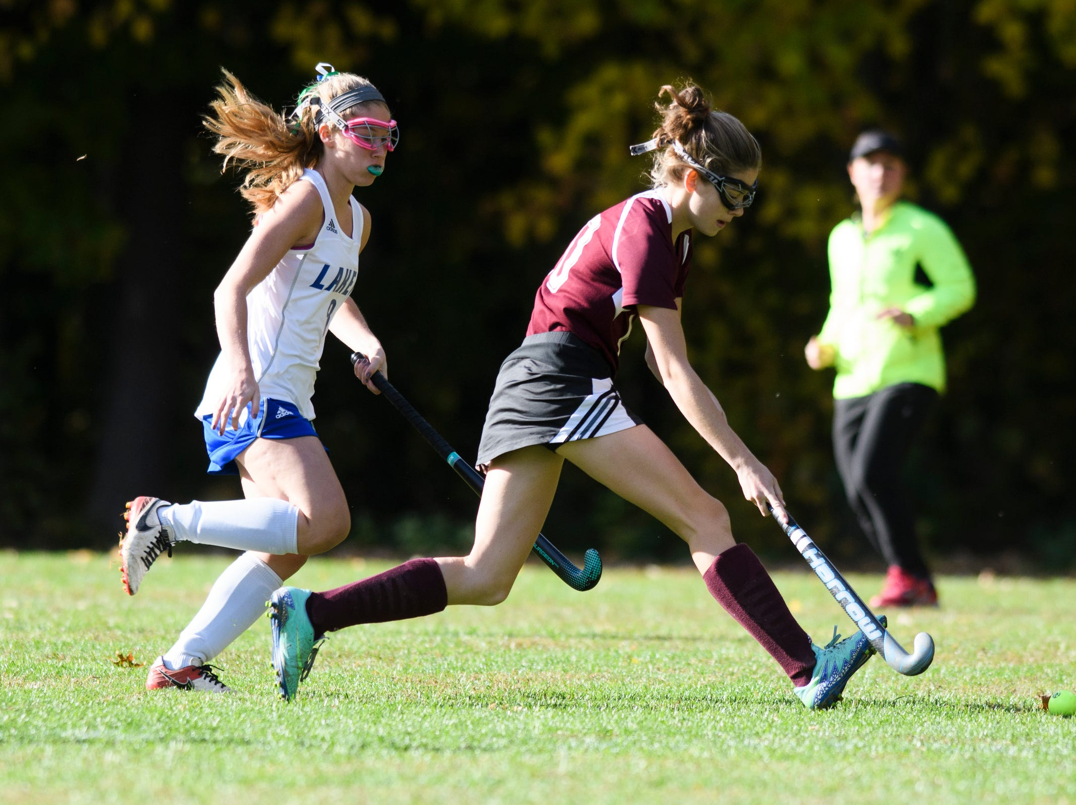 Mt. Abraham's Ava Konczal (10) runs down the field with the ball past Colchester's Brooke Barrows (8) during the field hockey game between Mount Abraham and Colchester at Colchester High School on Saturday morning October 20, 2018 in Colchester.