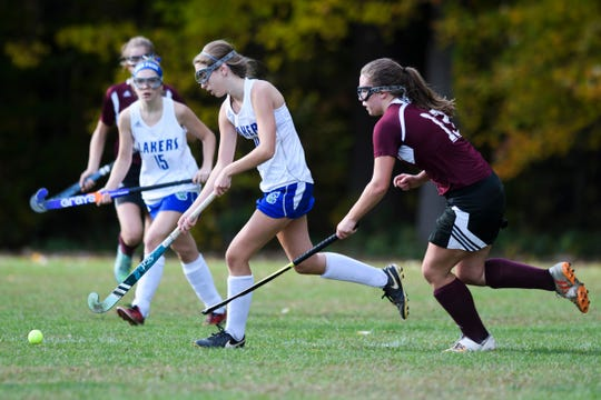 Colchester's Hannah Carroll (10) runs past Mt. Abraham's Abby Hoff (13) with the ball during the field hockey game between Mount Abraham and Colchester at Colchester High School on Saturday morning October 20, 2018 in Colchester.