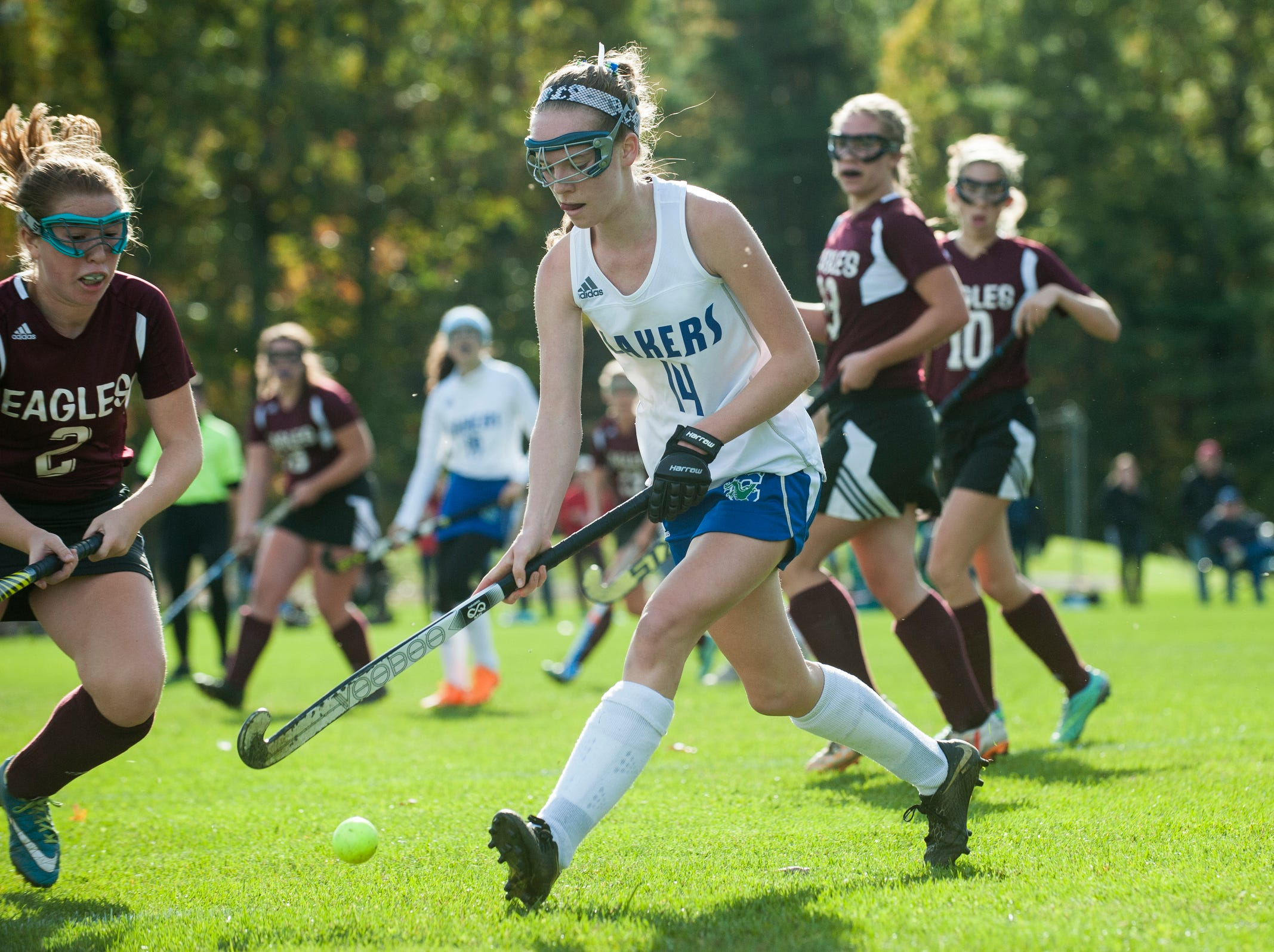 Colchester's Patra Bajuk (14) plays the ball during the field hockey game between Mount Abraham and Colchester at Colchester High School on Saturday morning October 20, 2018 in Colchester.
