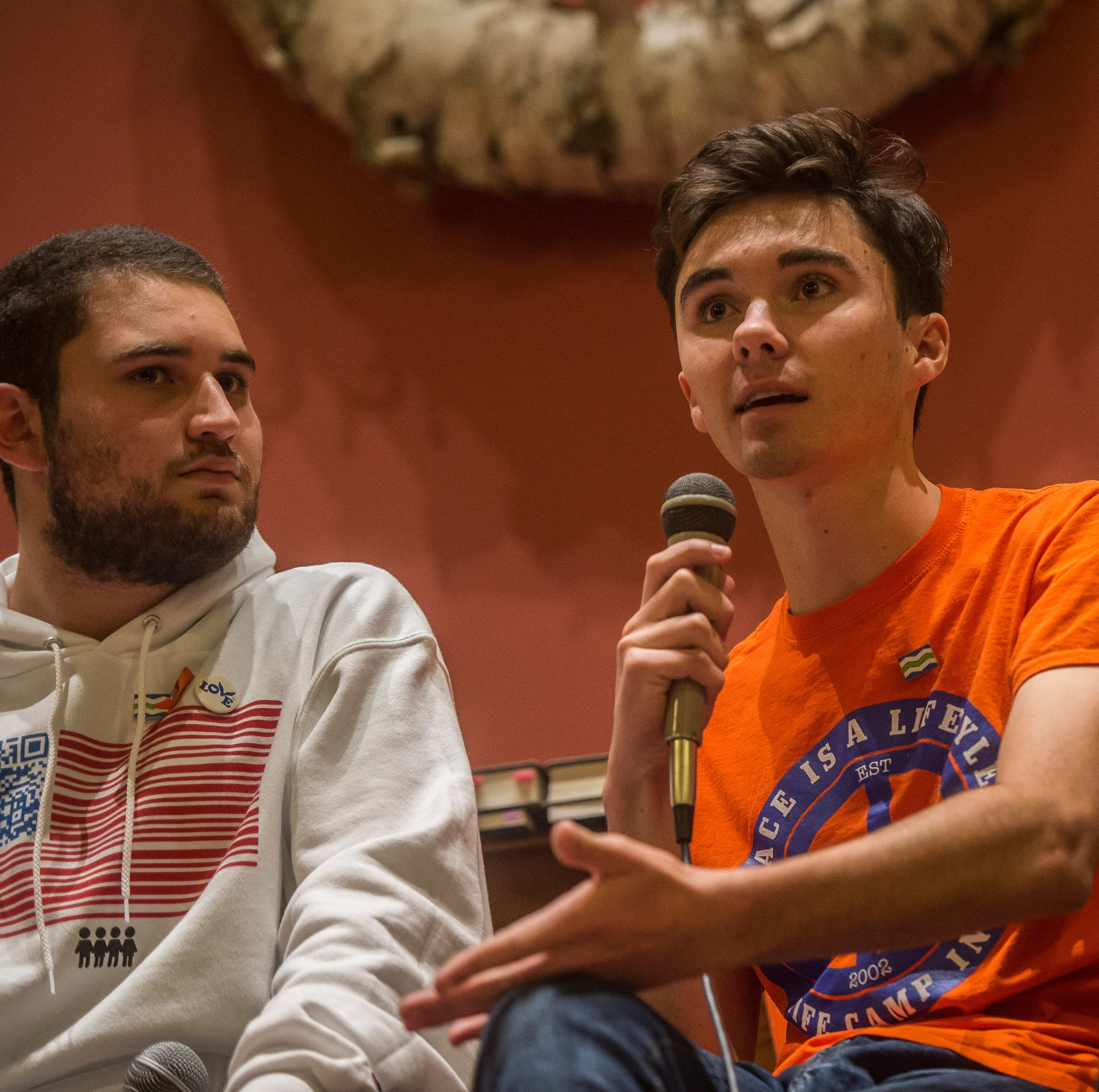"From left, survivors of the Marjory Stoneman Douglas High School shooting in Parkland, Florida, Alex Wind, David Hogg and Emma Gonzalez, speak Friday night, Oct. 18, 2018, at the First Unitarian Universalist Society of Burlington, Vt., part of a six-city tour promoting their book ""Glimmer of Hope: How Tragedy Sparked a Movement."""