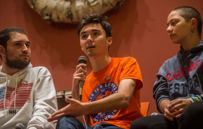 "Alex Wind, left, David Hogg and Emma Gonzalez speak Oct. 18, 2018, at the First Unitarian Universalist Society of Burlington, Vermont. The  three are survivors of the Marjory Stoneman Douglas High School shooting in Parkland, Florida, and were part of a six-city tour promoting their book ""Glimmer of Hope: How Tragedy Sparked a Movement."""