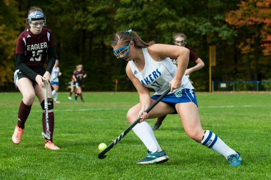 Colchester's Meg Lehouiller (17) plays the ball past Mt. Abraham's Elayna Jennings (15) during the field hockey game between Mount Abraham and Colchester at Colchester High School on Saturday morning October 20, 2018 in Colchester.