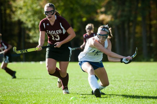 Colchester's Patra Bajuk (14) hits the ball down the field past Mt. Abraham's Abby Hoff (13) during the field hockey game between Mount Abraham and Colchester at Colchester High School on Saturday morning October 20, 2018 in Colchester.