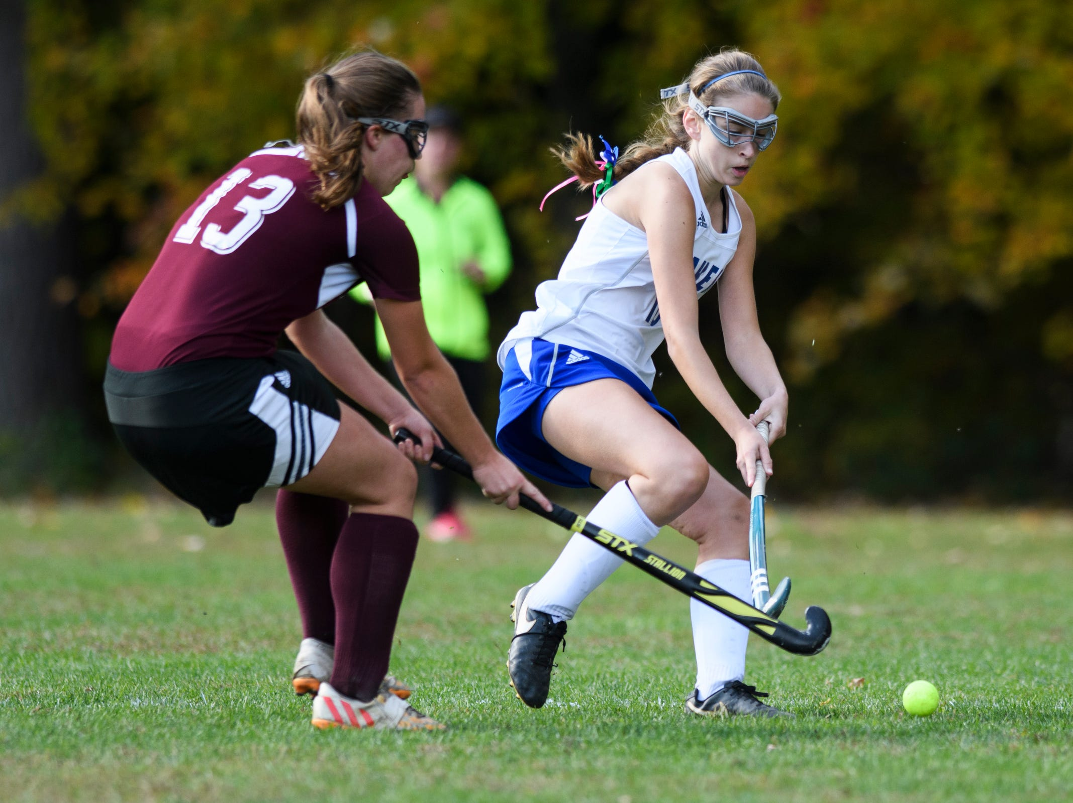Colchester's Hannah Carroll (10) and Mt. Abraham's Abby Hoff (13) battle for the ball during the field hockey game between Mount Abraham and Colchester at Colchester High School on Saturday morning October 20, 2018 in Colchester.