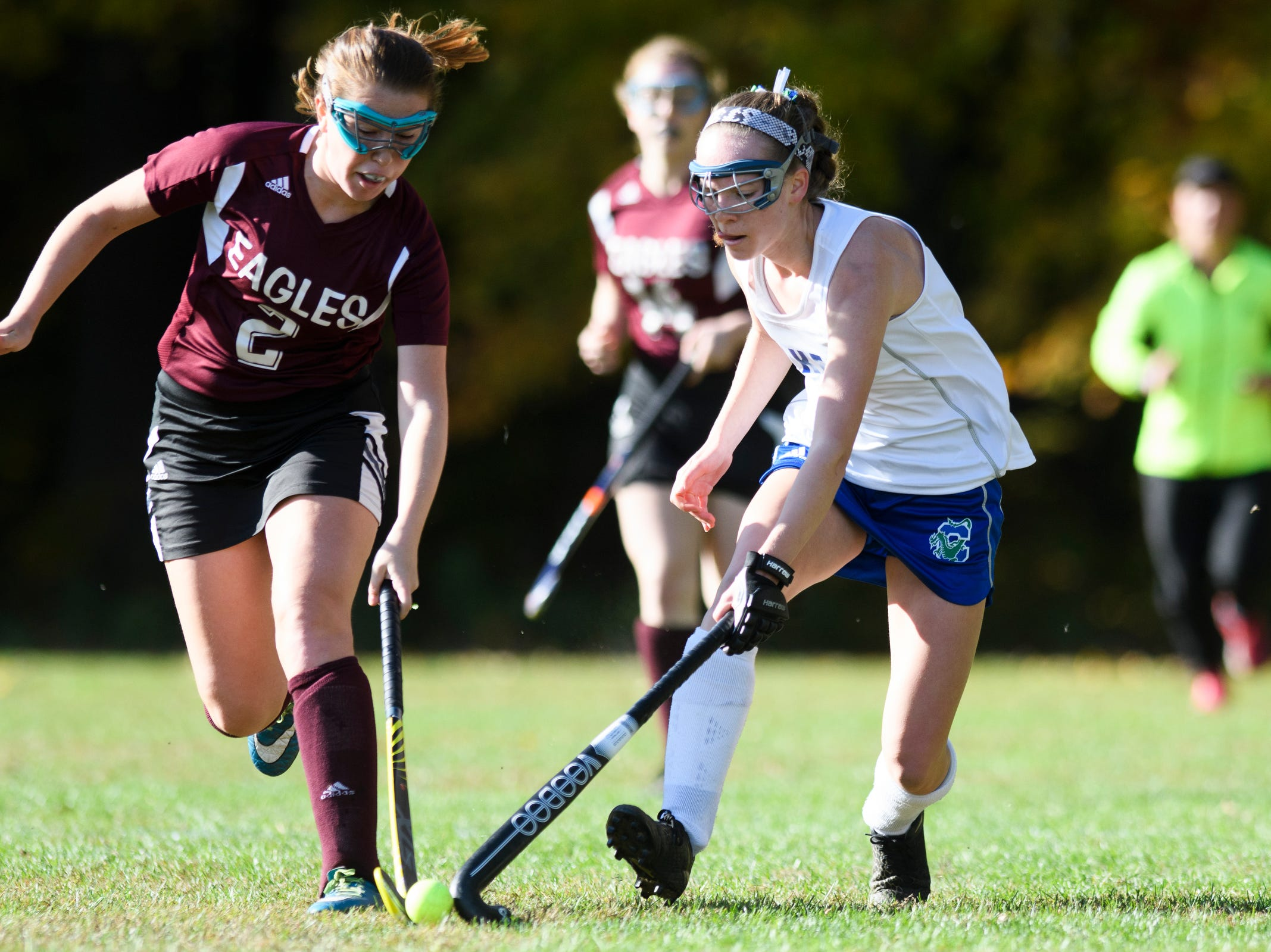 Colchester's Patra Bajuk (14) battles for the ball with Mt. Abraham's Elizabeth Porter (2) during the field hockey game between Mount Abraham and Colchester at Colchester High School on Saturday morning October 20, 2018 in Colchester.