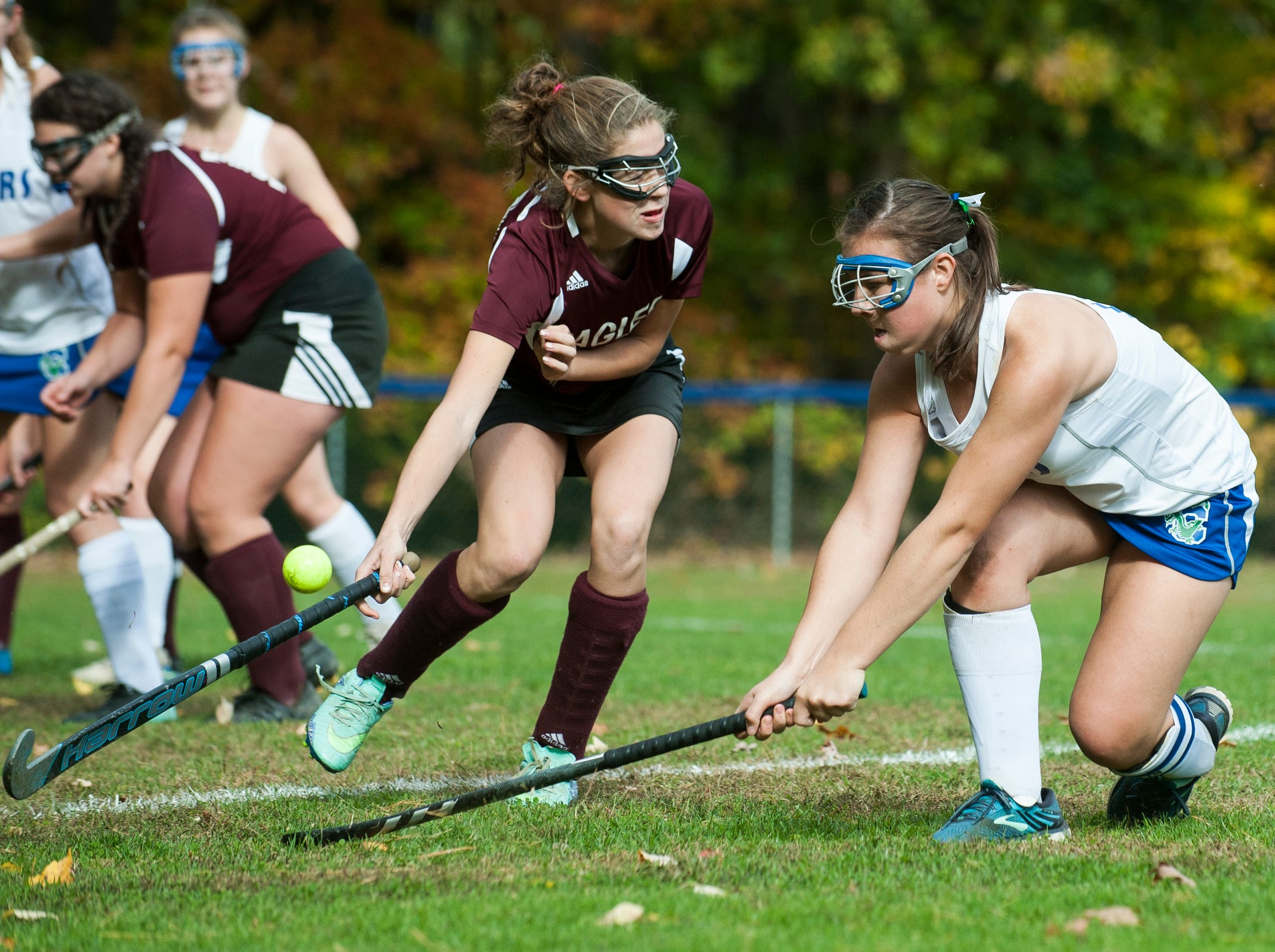 Colchester's Meg Lehouiller (17) hits the ball past Mt. Abraham's Ava Konczal (10) during the field hockey game between Mount Abraham and Colchester at Colchester High School on Saturday morning October 20, 2018 in Colchester.