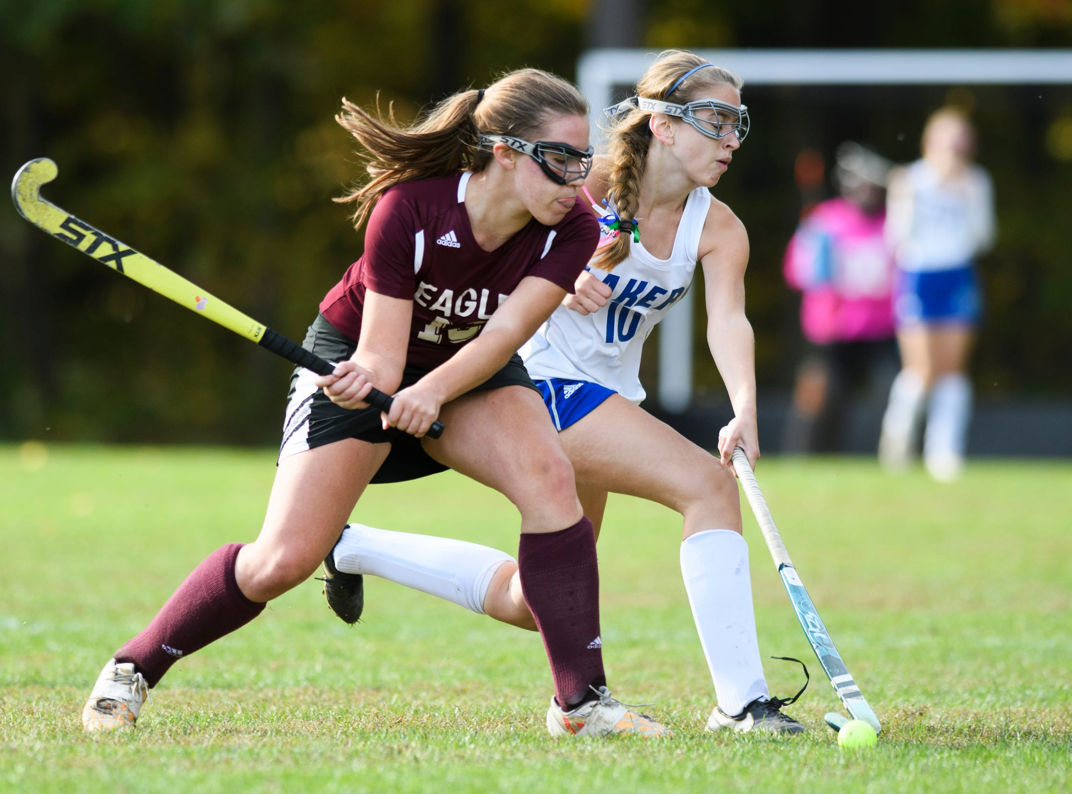 Colchester's Hannah Carroll (10) tries to block the shot by Mt. Abraham's Abby Hoff (13) during the field hockey game between Mount Abraham and Colchester at Colchester High School on Saturday morning October 20, 2018 in Colchester.