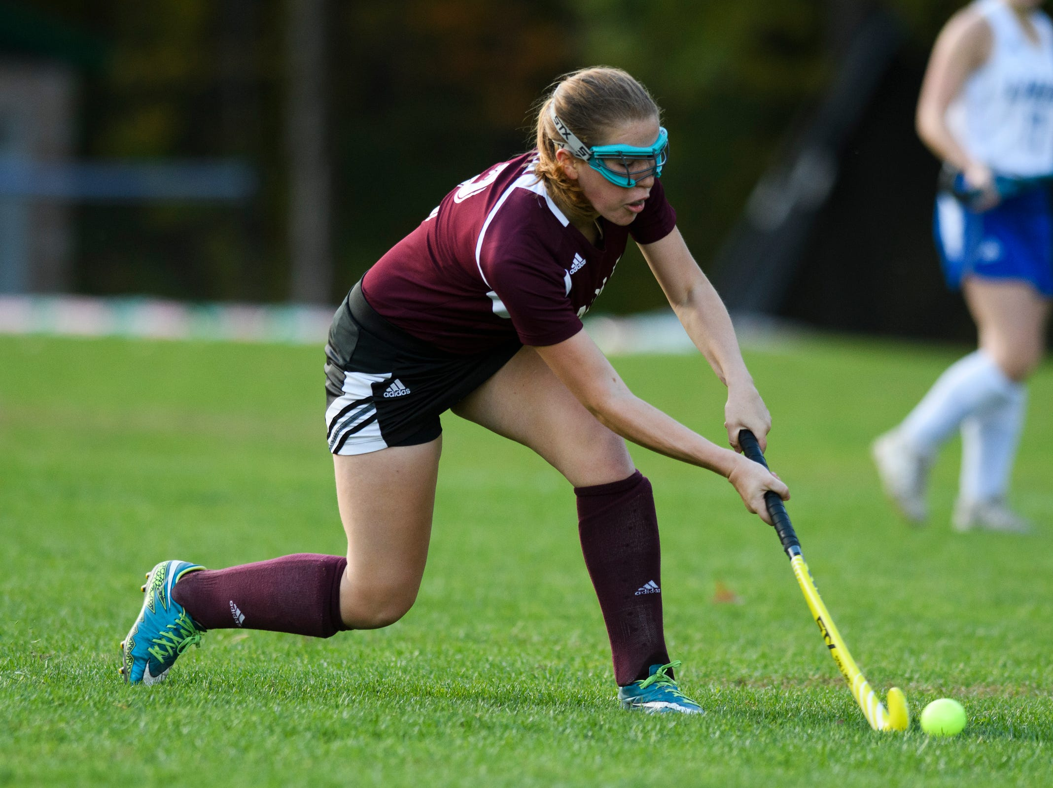 Mt. Abrahams Elizabeth Porter (2) hits the ball down the field during the field hockey game between Mount Abraham and Colchester at Colchester High School on Saturday morning October 20, 2018 in Colchester.