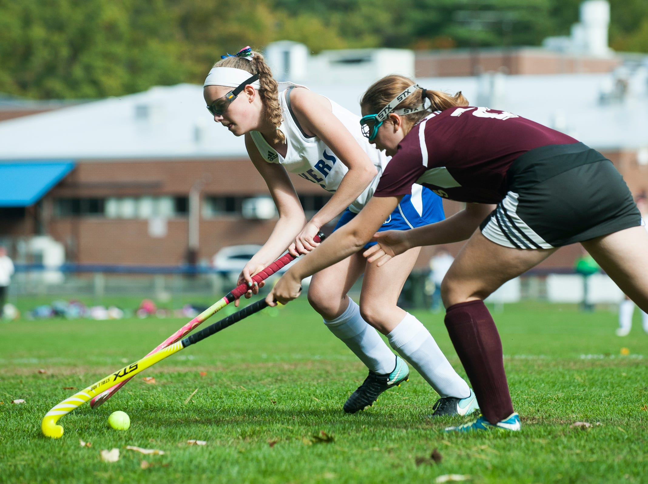 Colchester's Jackie Palaza (5) runs past Mt. Abraham's Elizabeth Porter (2) with the ball during the field hockey game between Mount Abraham and Colchester at Colchester High School on Saturday morning October 20, 2018 in Colchester.