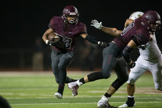 Flour Bluff's Isaac Miles rushes against Miller during their game on Friday, Oct. 19, 2018 at Flour Bluff High School .