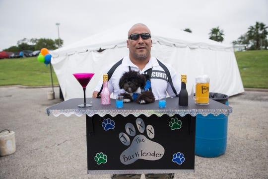 Joe Figueroa and his dog Jaxx get ready for the the 7th annual Bark in the Park on Saturday, Oct. 20, 2018 at Cole Park.