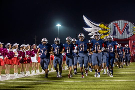 The Veterans Memorial Eagles prepare to take the field against Victoria East's on Friday, October 19, 2018 at Cabaniss Stadium.