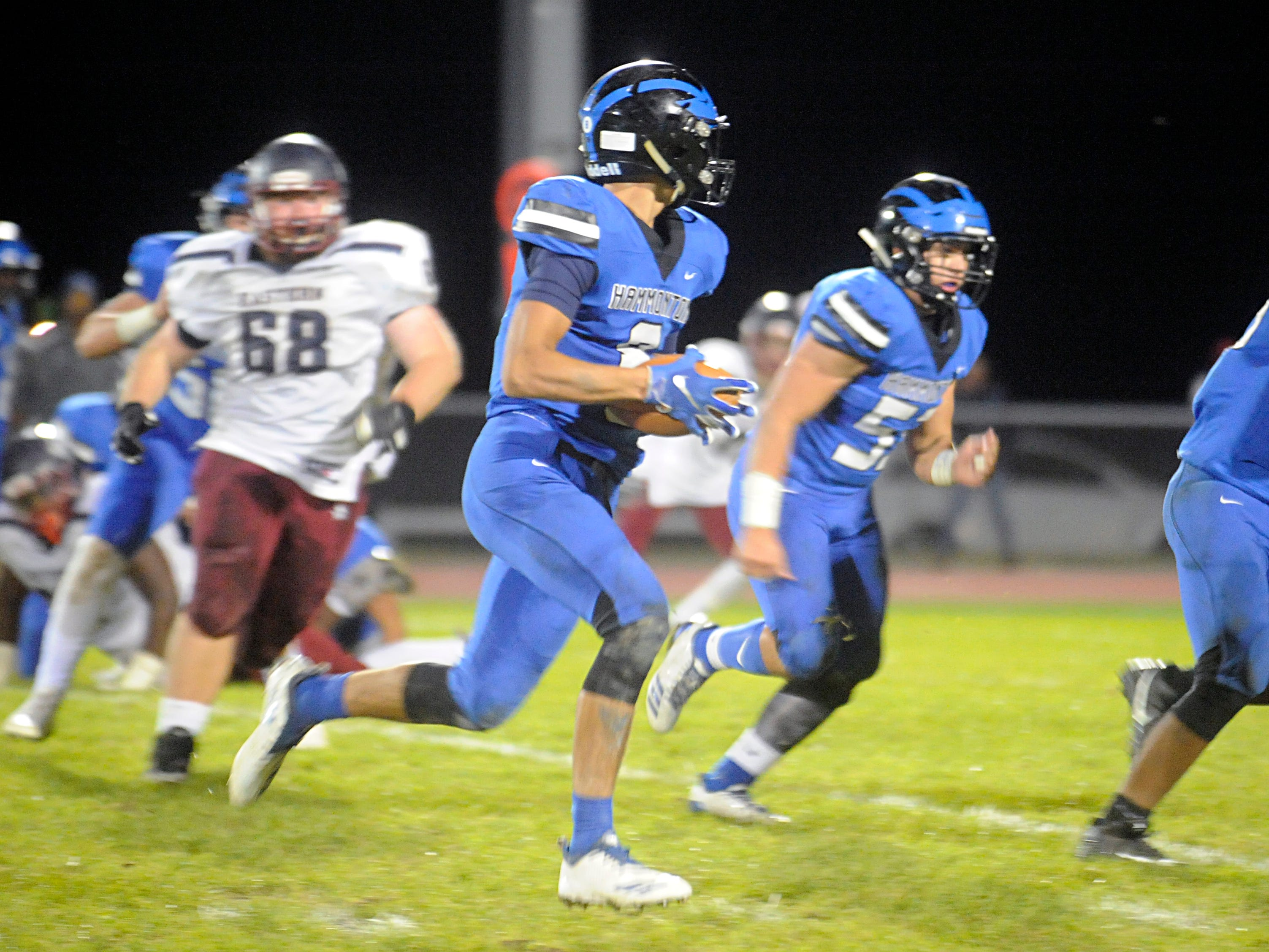 Hammonton's Christian Weissman catches a pass from Ryan Barts and runs for a gain against visiting Eastern. The Vikings topped the Blue Devils, 13-12, on Friday,