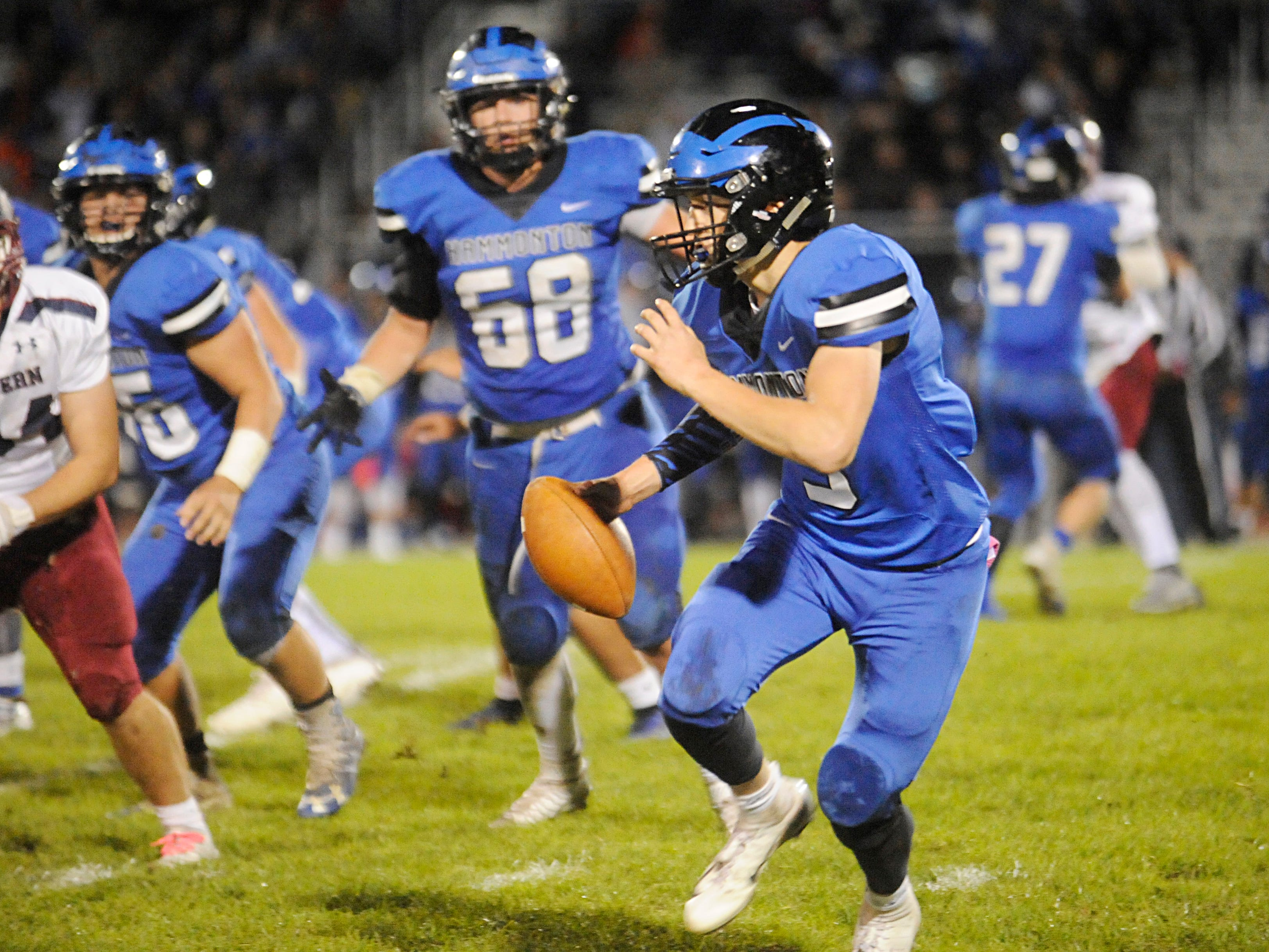 Hammonton's QB, Ryan Barts runs for a gain against visiting Eastern. The Vikings topped the Blue Devils, 13-12, on Friday, October 19, 2018.