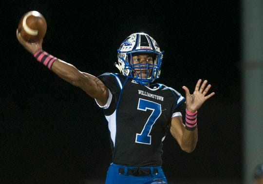 Williamstown quarterback Jonathan Collins throws a pass during the 1st quarter of Friday night's football game between Williamstown and Shawnee played at Williamstown High School on October 19, 2018.