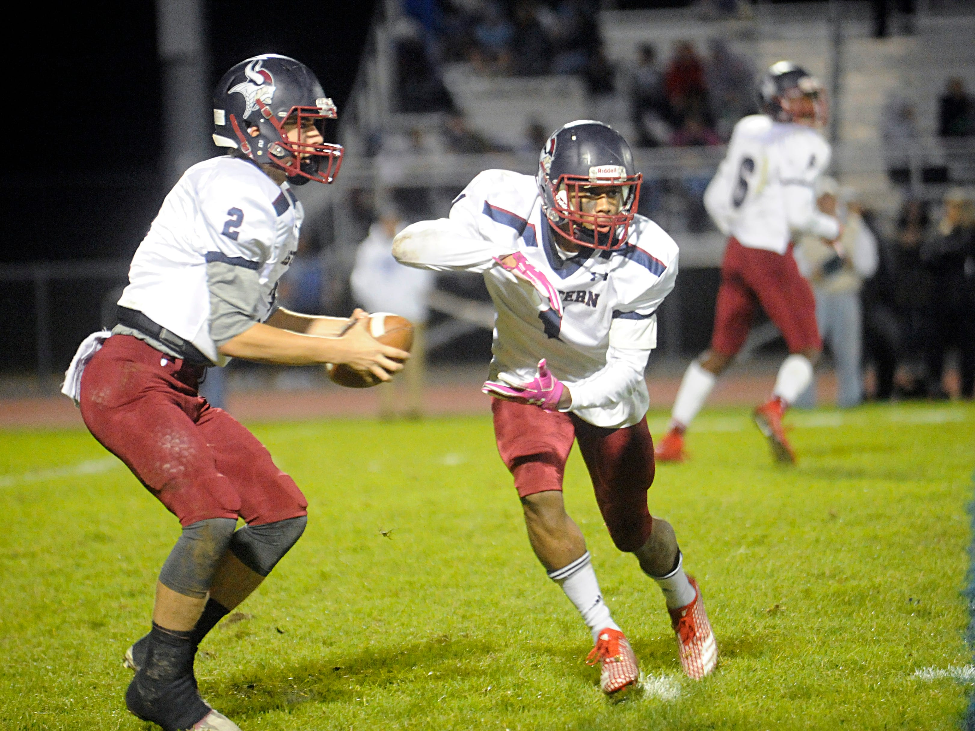 Eastern's QB, Andrew Heck pulls a fake handoff with Mike Suarez before throwing downfield against Hammonton. The visiting Vikings topped the Blue Devils, 13-12, on Friday, October 19, 2018.