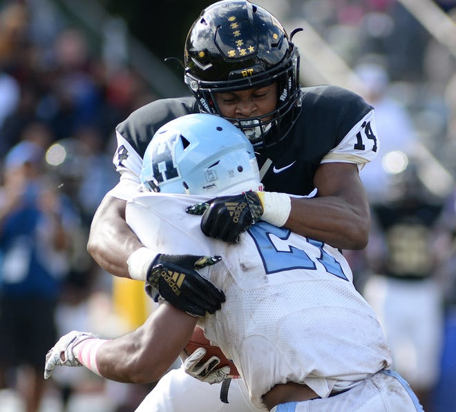Burlington Township's Tyrese Ware tackles Highland's Jaheim Armstrong in the fifth-ranked Falcons' 14-13 win over the seventh-ranked Tartans on Saturday.
