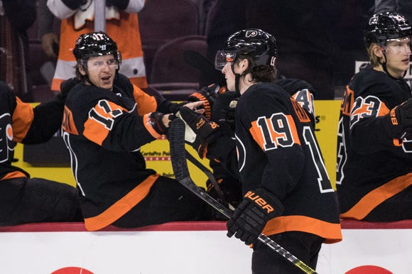 Travis Konecny, left, and Nolan Patrick, center, both scored in the Flyers' 5-2 win over the New Jersey Devils Saturday.