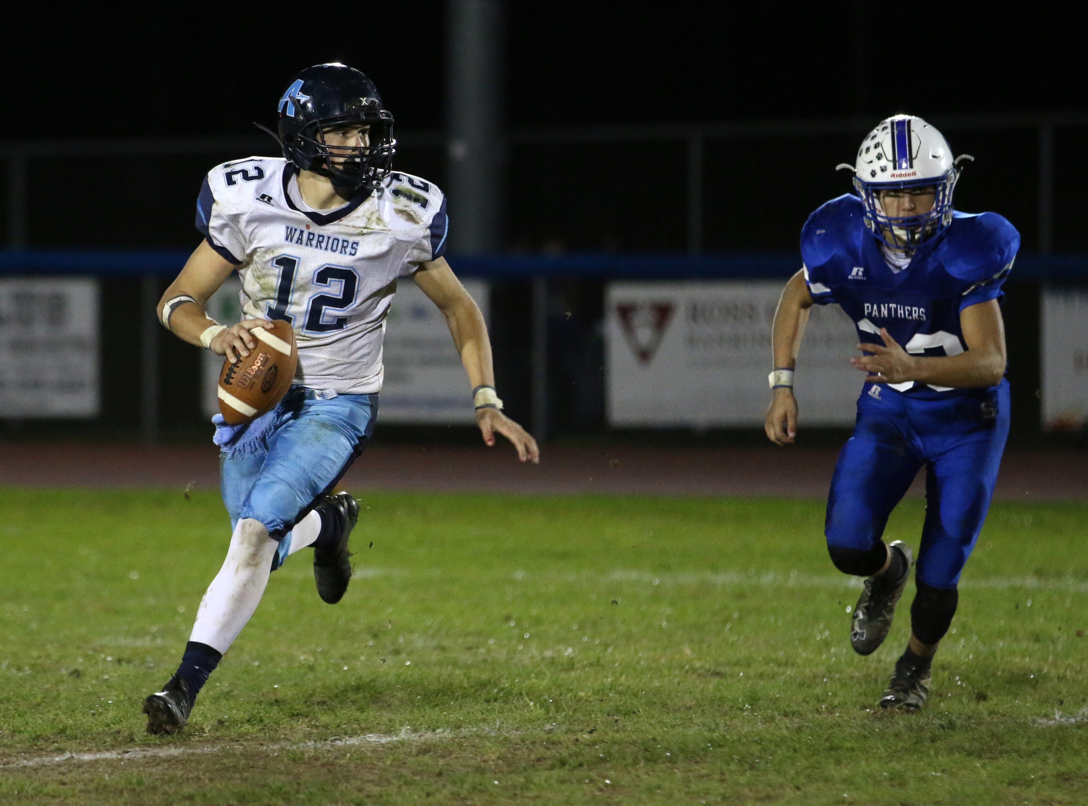 Adena QB, Preston Sykes scrambles while looking downfield for an open receiver Friday night at Southeastern High School.  Adena defeated Southeastern 33-30.