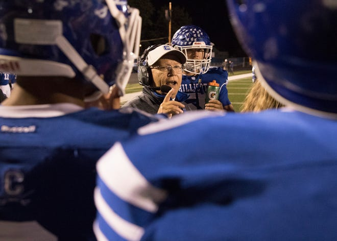 Coach Arndt talks strategy to several football players during the second half of their game against Washington Courthouse on October 19, 2018.