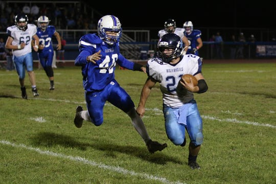 Adena running back Dalton Metzger runs the ball during a 33-30 win over Southeastern in 2018.