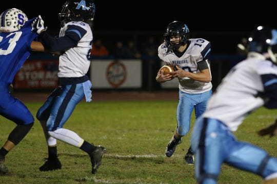 Adena's Nate Throckmorton carries the ball against Southeastern in a 33-30 win over the Panthers in 2018. Throckmorton hopes to get 1,000 yards this season.