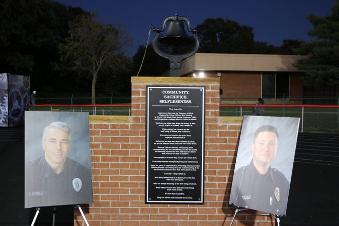 Westerville South High School dedicated a new victory bell andplaqueto fallen Westerville police officers AnthonyMorelli and Eric Joering during its Thursday night football game.