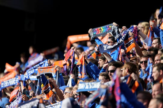 FC Cincinnati fans listen to the national anthem before the first half during a USL soccer playoff game between Nashville SC and FC Cincinnati,Saturday, Oct. 20, 2018, at Nippert Stadium in Cincinnati.