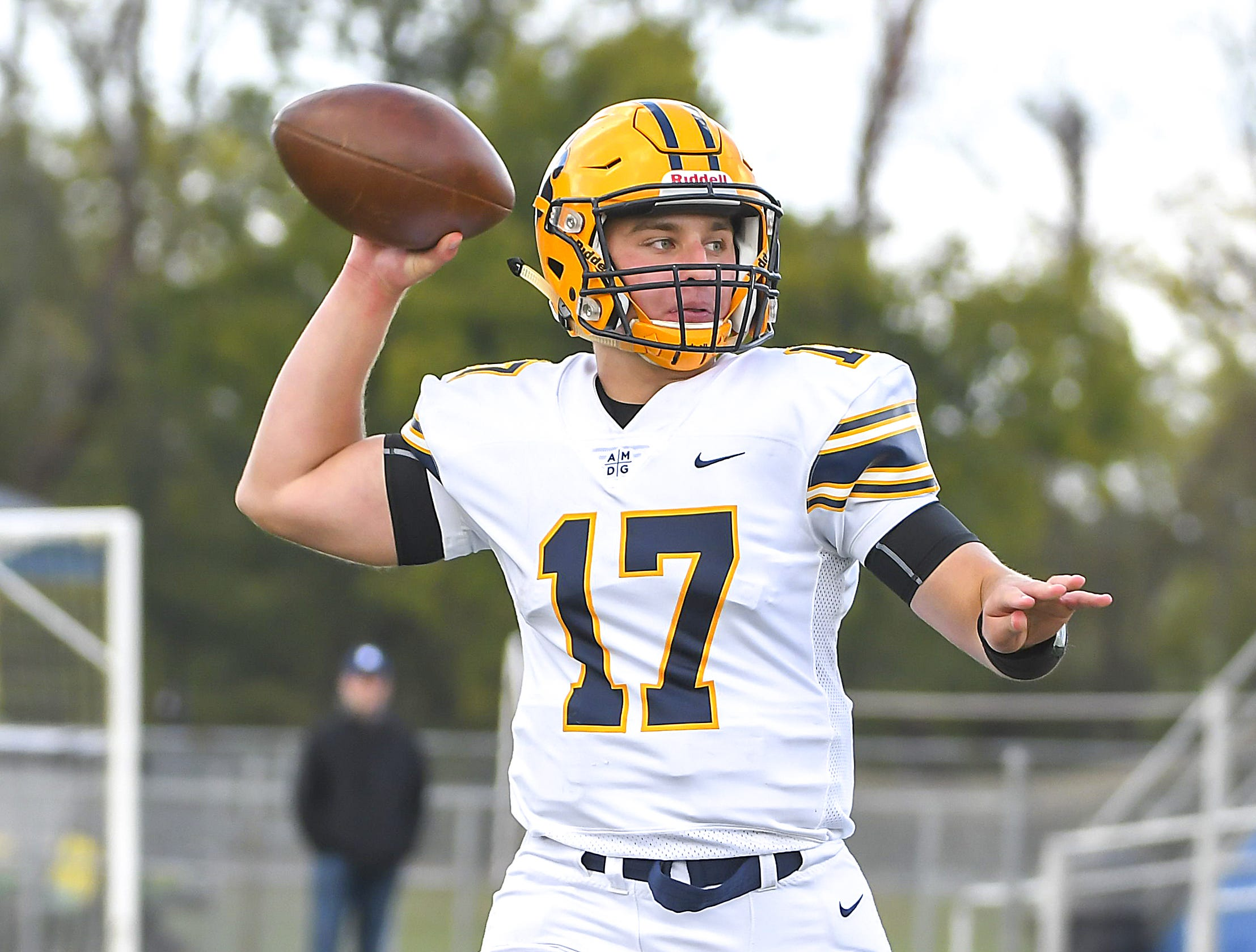 Cleveland St. Ignatius quarterback Patrick Delahunty passes the football for a touchdown against St. X at St. Xavier High School, Saturday, October, 20 2018